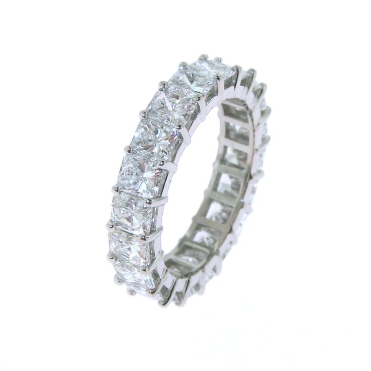 New This custom made eternity ring features perfectly matched colorless radiant cut diamonds set in shared prongs