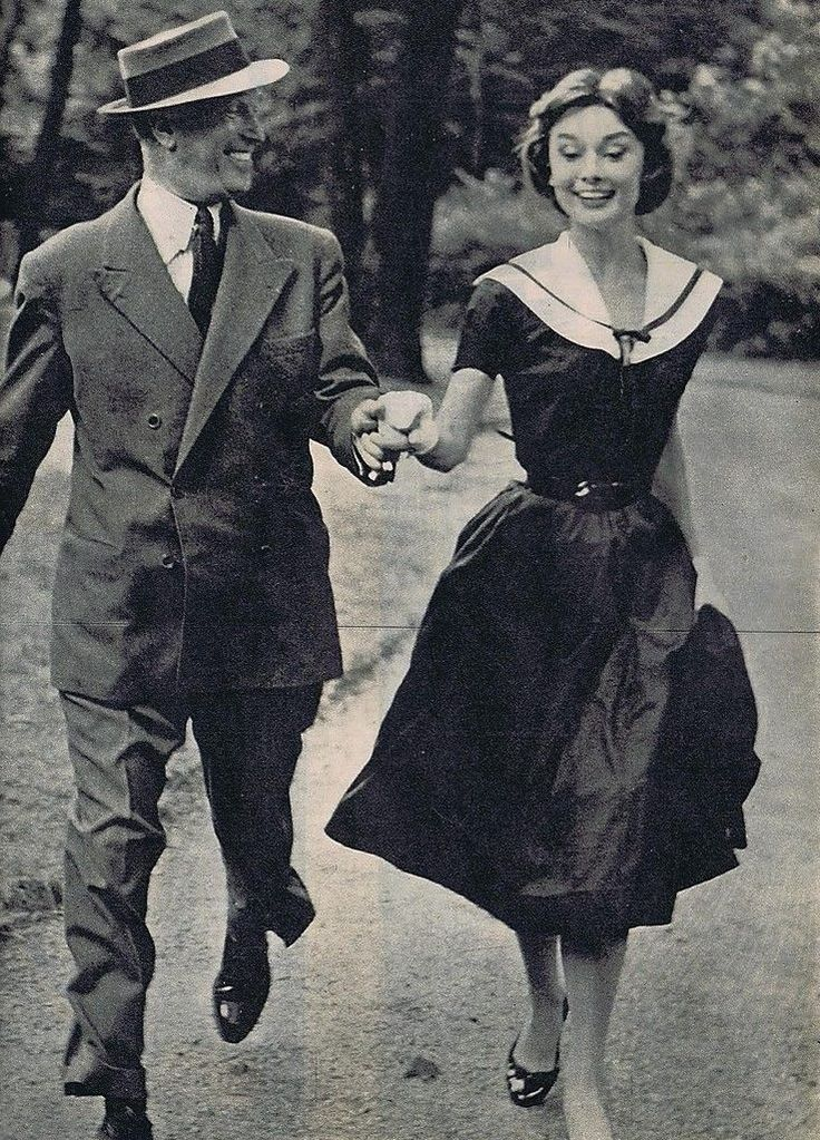 Audrey Hepburn with Maurice Chevalier in a Givenchy Boutique Paris 1956 sailor style dress of crepe de Chine in navy blue, collar in white pique with detail of a ribbon of satin in navy blue; Hermes belt and Mancini shoes.