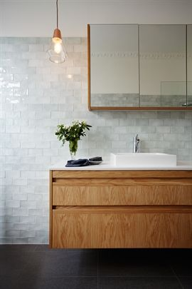 The timber veneer in this bathroom is a great feature with the white and grey palette