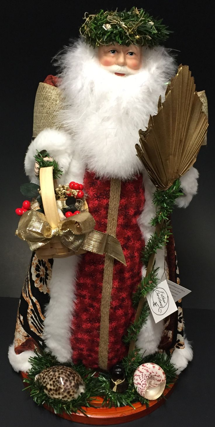 "18-20"" Tropical Hawaiian Santa dressed in a ""Tapa"" printed cloak. Wearing a Hawaiian Haku upon his head, holding a staff, carrying a basket full of goodies and shells at his feet on a wooden base. Eac"