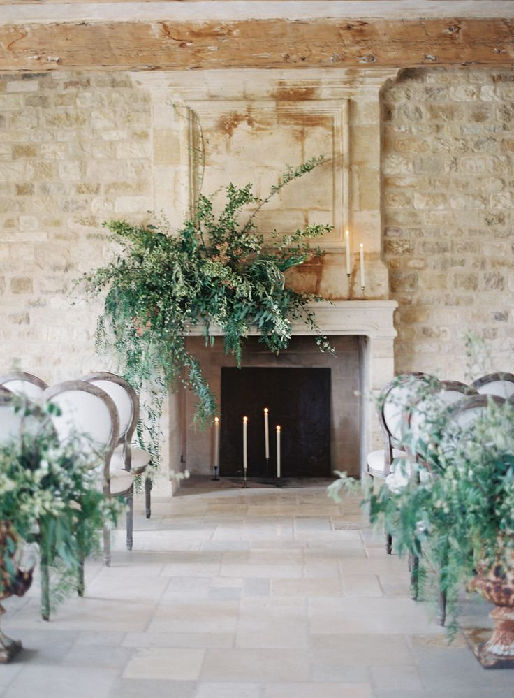 Organic indoor Ceremony in front of a fireplace with candles. Joy Proctor Design, Amy Osaba and Kurt Boomer Photography