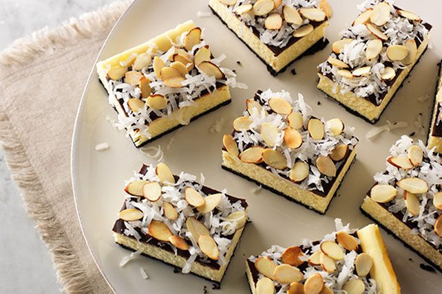Make these Coconut Joy Cheesecake Bars that taste like your favorite candy bar. Coconut Joy Cheesecake Bars are a great treat for your next party.