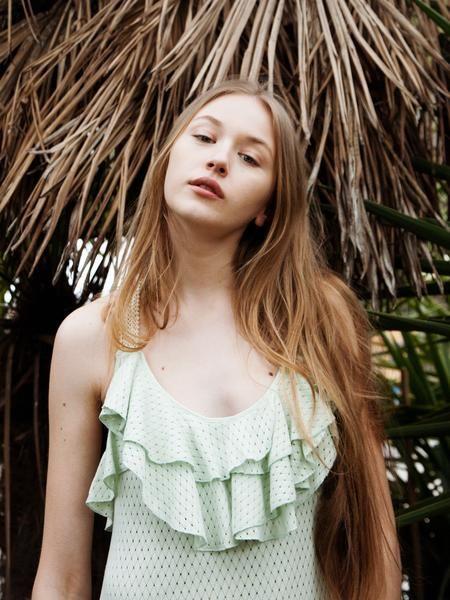 Mint diamond knit cotton blend dress with open back.