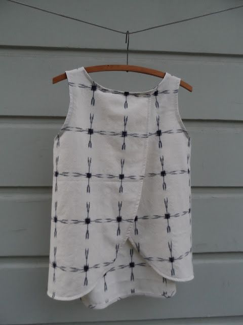 Could do this variation on the Sorbetto top: all dressed up and nowhere to go: SPLIT BACK TINY POCKET TANK : THE TUTORIAL