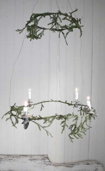 Christmas wreath chandelier with candles, Scandinavian style