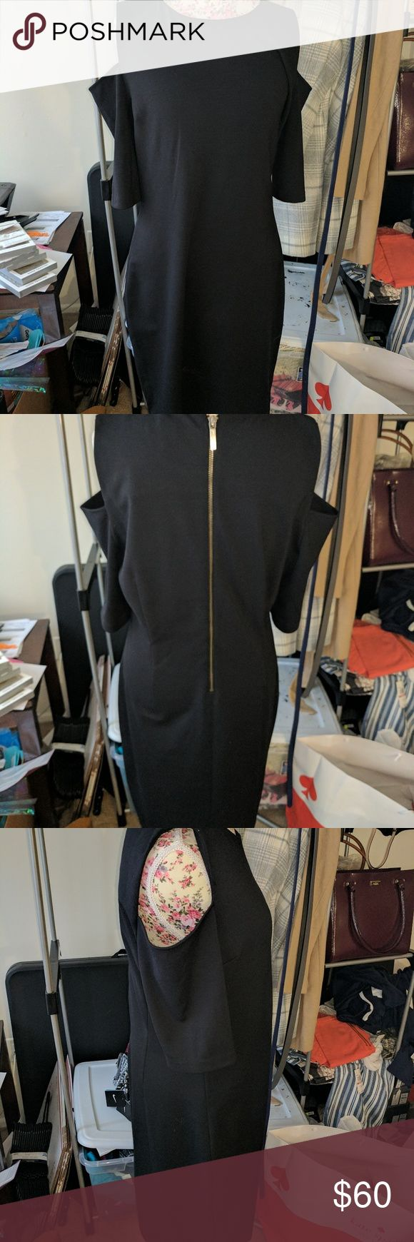 Michael Kors black cold shoulder dress New with tags black cold shoulder dress with gold zipper.  There is some deodorant on dress from someone trying on, not permanent I just like to mention everything.  Size XL. #michaelkors  #littleblackdress #coldshoulder Michael Kors Dresses