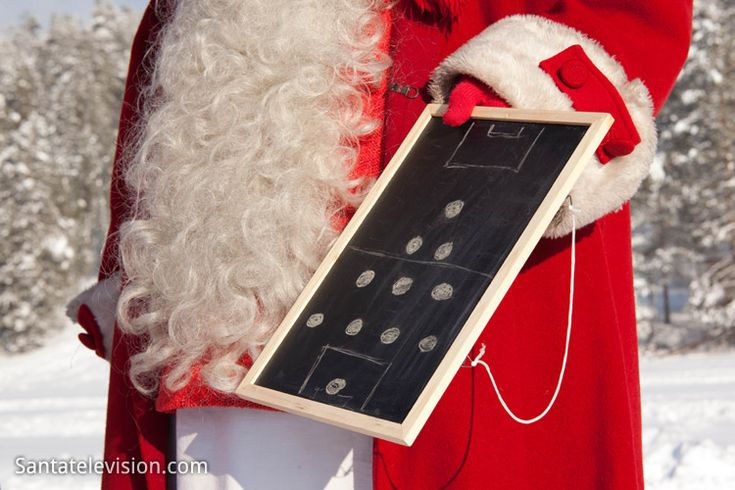 Santa Claus giving instructions for his football team FC Santa Claus Rovaniemi