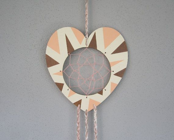 Plywood heart dreamcatcher.
