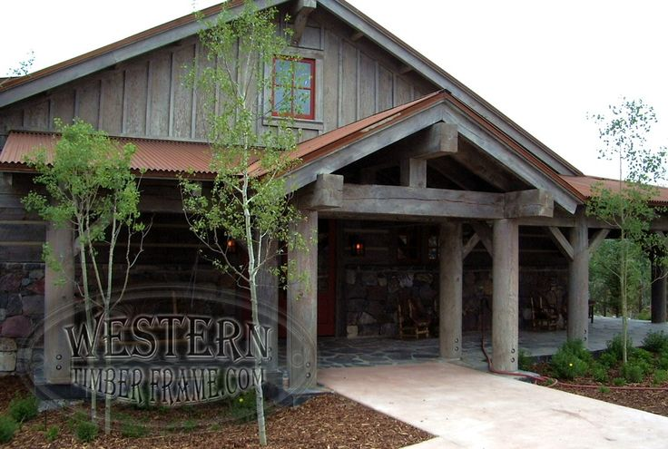 Timber Cabin Covered Deck With Truss Entryway Supported