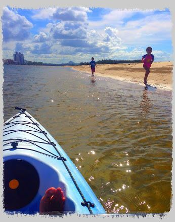 Still trying to wear the kids out and kayaking seems like a winner, Robbie paddles, while the kids run up and down the sandbar. Everyone is happy.