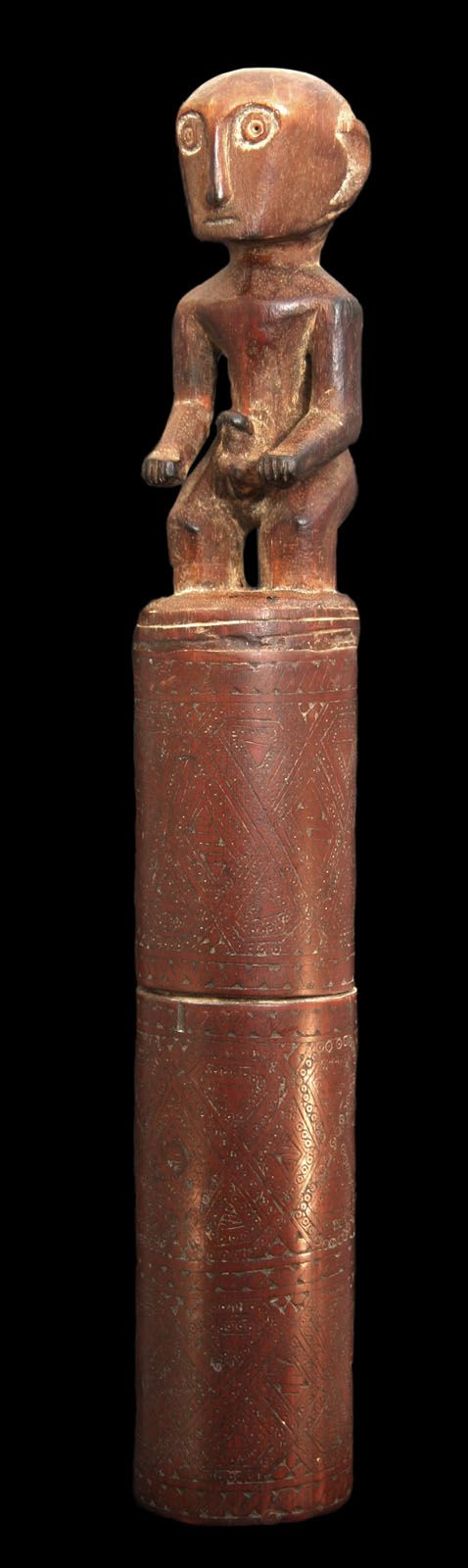 "Carved Wood And Bamboo Lime Container. Lime paste is one of the three ingredients for making betel quid, the other two being a leaf from the vine of the piper betel pepper plant, and thin slices of the areca-nut. Chewing the mixture of areca nut and betel leaf is a tradition, custom or ritual which dates back thousands of years from South Asia to the Pacific. Location: Indonesia | Dimensions: 9.5"" x 1.25"" x 1.5"". See more items at londoncoin.com"