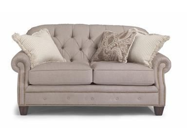 Create a living room that's light and feminine as well as cozy and comfortable. This button-tufted loveseat is the perfect centerpiece for a sophisticated, transitional room.
