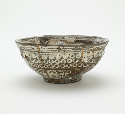 Joseon period, 15th century Korea Stoneware with white inlay under transparent glaze; gold lacquer repairs 5.9 x 13.2 cm