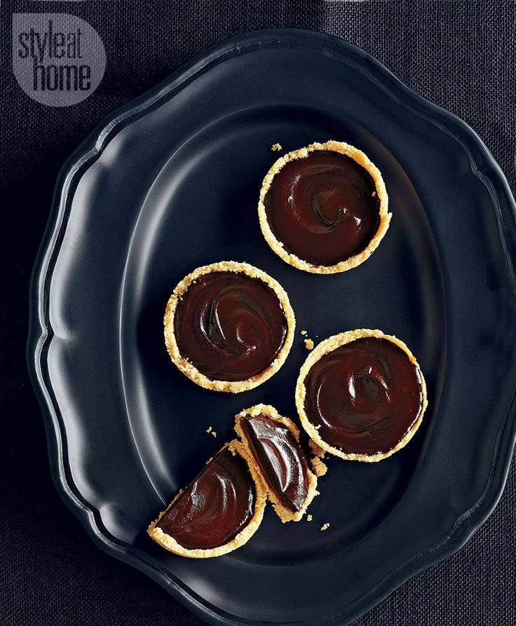 Dark Chocolate Salted Caramel Tarts. Shot by Maya Visnyei