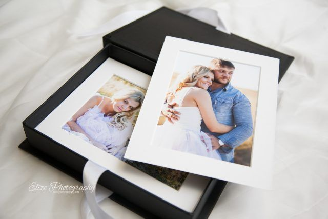 Heirloom Folio Collection is a sophisticated folio box filled with your most cherished photographs. The prints are framed in a white matt, and they presented in an elegant black box with satin ties.