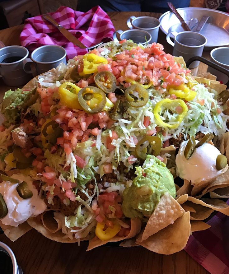 Have you heard about the secret Disney nachos at Pecos Bill Inn Tall Tale Inn & Cafe in Frontierland? $90 for a huge plate of nachos and so much more!