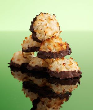 Coconut Macaroons + Chocolate = Perfection. Oh my goodness. These are so simple and smell like heaven. Next time (and there WILL be a next time!) I think I'll just drizzle the chocolate on the top, or even put a hershey kiss on top for the last few minutes in the oven to melt it. If I do dip it, I'll use the whole bag of chocolate chips (it only calls for half).