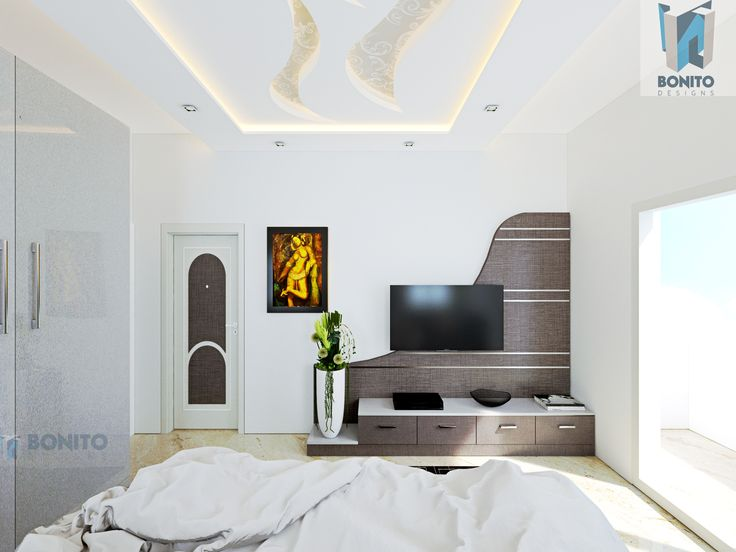 How can a bedroom be complete without a sleek TV unit?  A cosy bedroom with sophisticated interiors rendered for the 5BHK bungalow in Bettahalasur #BedroomDeisgns