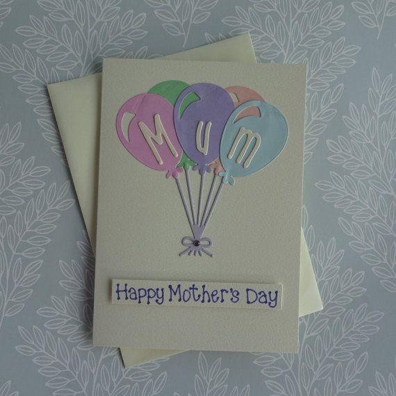 Unique Mothers Day balloon card. Handmade card for Mum with a bunch of balloons.  This Mothering Sunday card has a bunch of balloons in pastel colours (although you can choose alternative colours from the drop-down menu) and a gem added to the bow at the bottom of the strings of the balloons. The sentiment on this Happy Mothers Day card is added with 3D foam and reads: Happy Mothers Day. The message is added with metallic lilac glitter ink.  FRONT OF THE CARD: The card can be personalised…