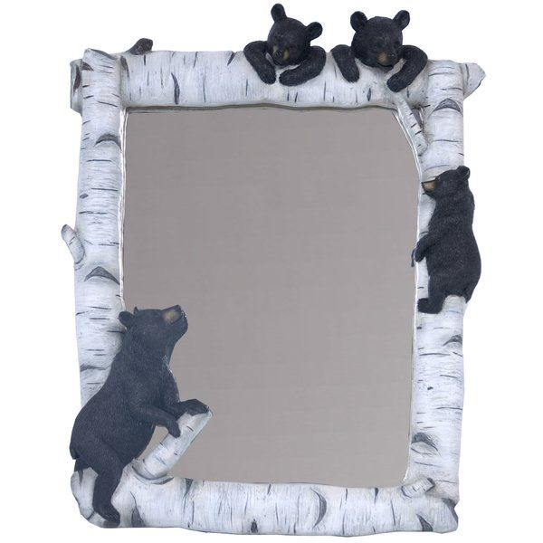 This polyresin birch mirror features two black cub bears resting on top of the branch while the third tries desperately following to be with his brothers. As mama bear watches over them with the over protective look.