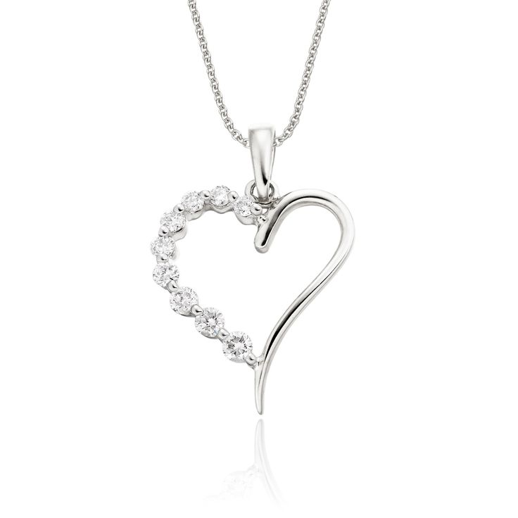 This elegant white gold diamond pendant has 0.20ct diamonds. The heart shape pendant features an graduating line of diamonds on one side with a mirror polished finish on the other. This necklace is made in 9K white gold and is available complete with a beautiful mirror trace chain or if you already have a chain then you have the option to buy just the pendant.