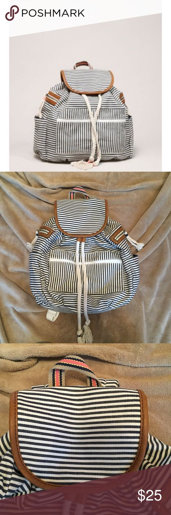 American Eagle Striped Nautical Backpack American eagle navy blue and cream striped backpack! With 4 outside pockets! Has fringe and tassels! Only used once! Inside is perfectly clean. American Eagle Outfitters Bags Backpacks