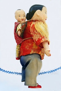 Chinese doll carrying a baby from the White Elephant Sale.