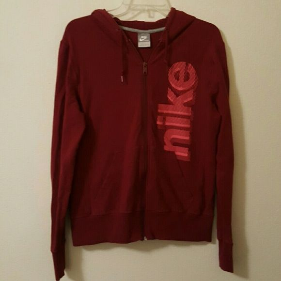 Nike women's zip up hoodie. Size L Women's Nike zip up hoodie. Maroon/red color with pink lettering. Size L. Open to any offers on all items in my closet! Nike Tops Sweatshirts & Hoodies