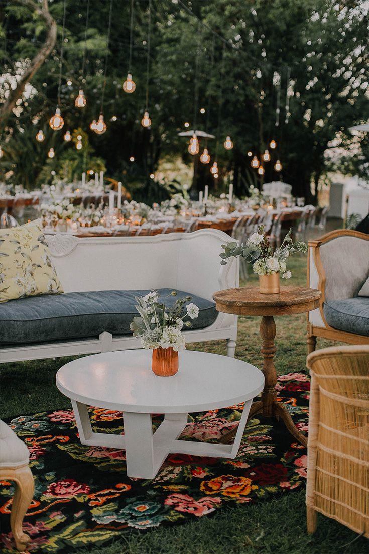 Beautiful lounge area decor at wedding reception. Boho chic.