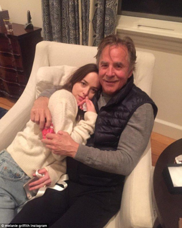 Dad and daughter: Melanie Griffith posted a snap of daughter Dakota Johnson and ex-husband Don Johnson celebrating the holidays together