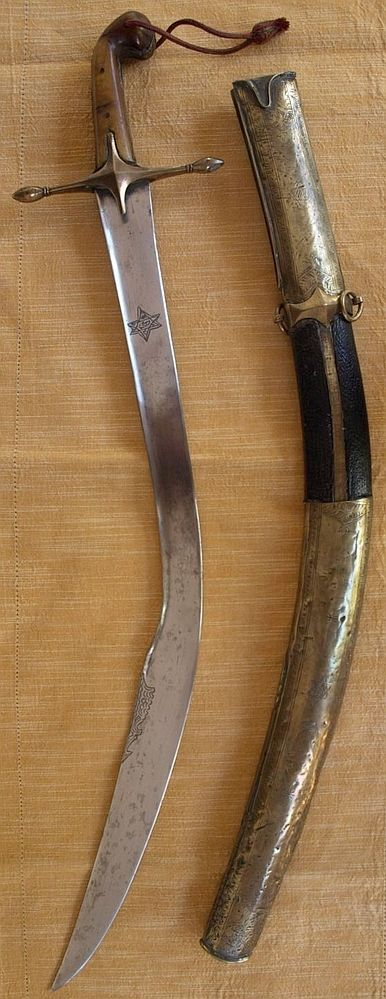 The short version of the Ottoman kilij sometimes known as ''pala'', with deeply curved wide blade and 'T' spine, used from the early 17 C. for more than 300 years well into the 20th C. The hilt of classical form is made of brass cross guard and horn grips with bulbous pommel and brass grip strap. The original wood scabbard is covered with leather, mounted with chased brass locket and chape. length 32.09 INCHES (81.5cm), blade 26.77 INCHES (68cm), length with scabbard 33.86 INCHES (86cm).