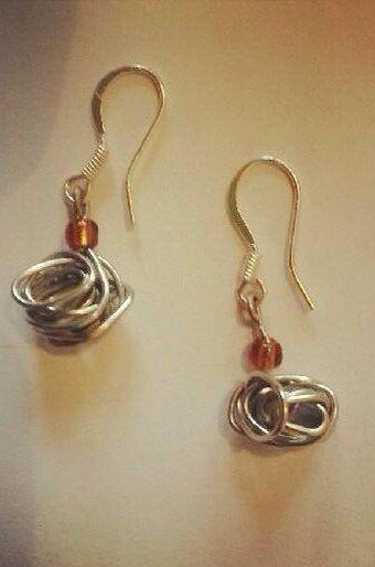 Glory in the mundane.  Wrapped wire and glory seed bead earrings.  Sterling silver earring hooks.$20 Www.sozojewellerydesigns.com
