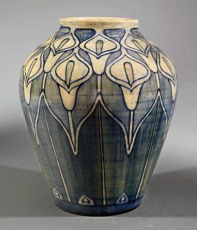 Newcomb College Art Pottery High Glaze, 1902. Decorated by Mary Williams Butler with a pattern of calla lilies in underglaze blue and blue-green. Joseph Meyer's potter's mark.