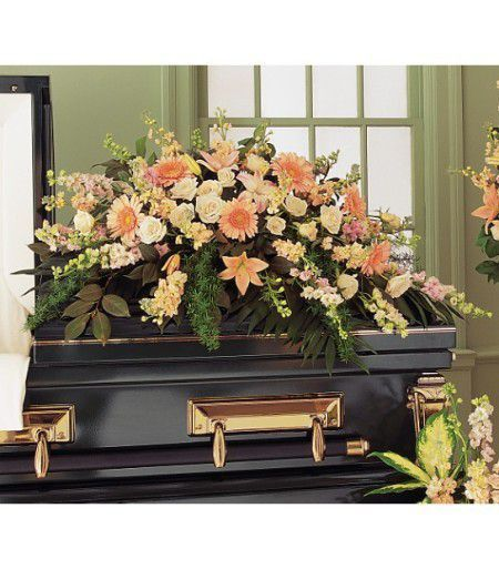 Peach Sympathy Casket Spray consists of rich and colorful display uses nature's most beautiful flowers in shades of peach. Appropriate to display on a casket.