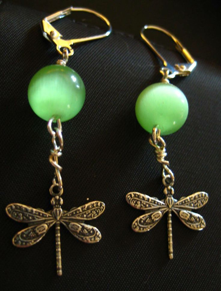 Catseye & Dragonfly Earrings - Green catseye stone and dragonfly drops. Leverback style earring hooks.  $2.99 available at http://www.beaddesignsbysandy.com/shop/clearance-items/