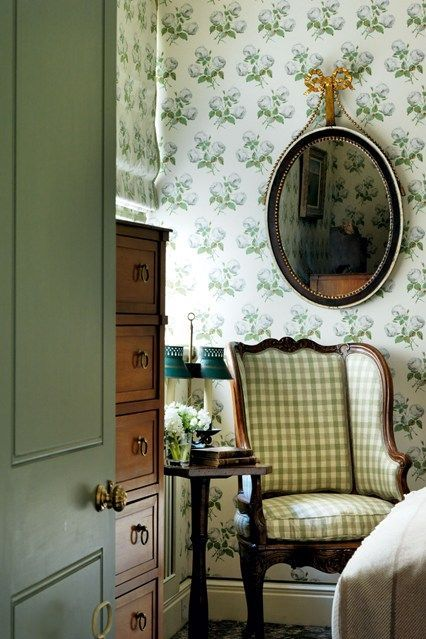 Colefax & Fowler paper, matching roman shade,green gingham, and a green door? That bow-topped mirror? English loveliness by Roger Jones.