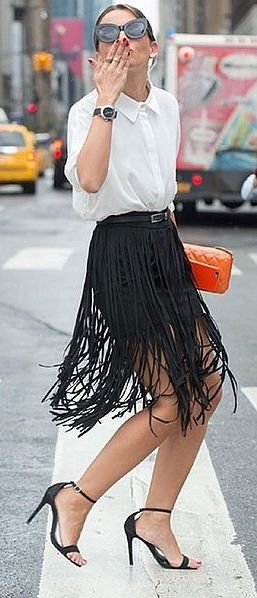 A Button-Up Tucked Into a Fringed Skirt
