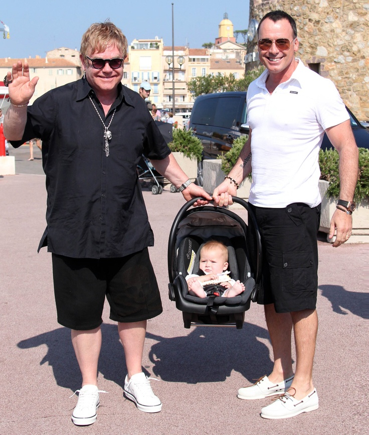 "World Congratulates Elton John & David Furnish on New Child; Elton Says ""News to Us"""