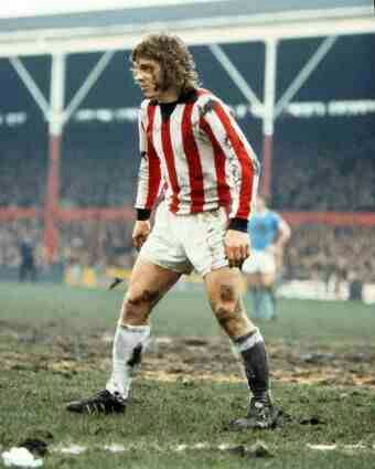 Mike Pejic of Stoke City in action against Man City in 1974.