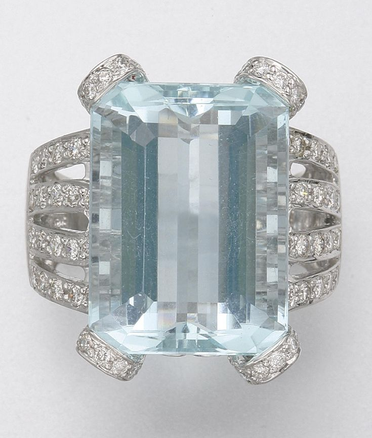 18K WHITE GOLD, AQUAMARINE AND DIAMOND RING.  1 aquamarine and 140 diamonds approx 16.25 & 1.20 cts
