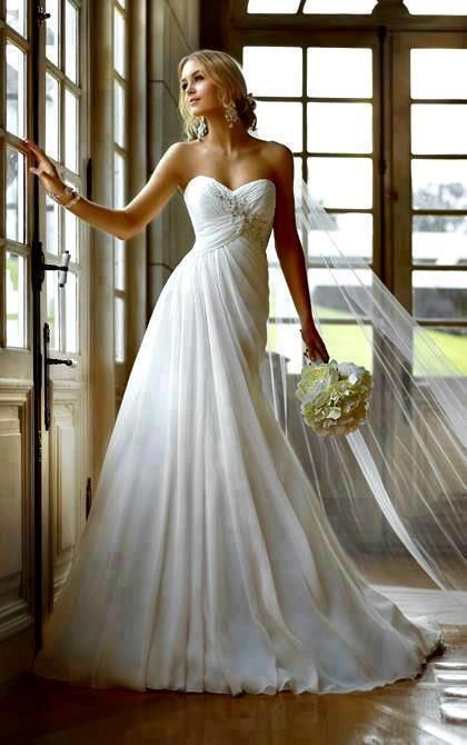 Simple wedding dress ...not for me, but stunning none the less.