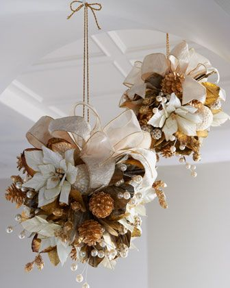 Golden Christmas Kissing Balls Gold and white kissing ball of poinsettias, pine cones, pearly berries, shells, and an ivory bow provides a festive ornament for your hall or entryway.
