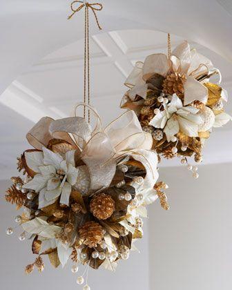 Golden Christmas Kissing Balls Gold and white kissing ball of poinsettias, pine…