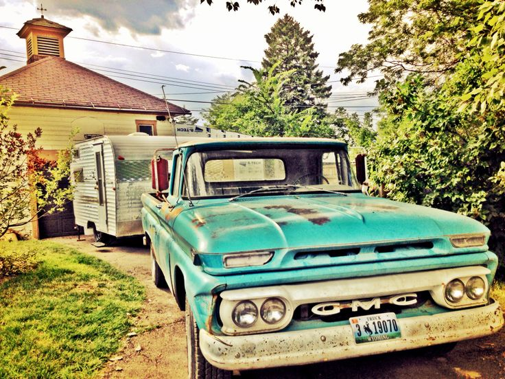 """I passed a small, vintage """"canned ham"""" style camper trailer on my way to work. She was sitting in a field, little forlorn """"For Sale"""" sign posted, alone save for a John Deere…"""