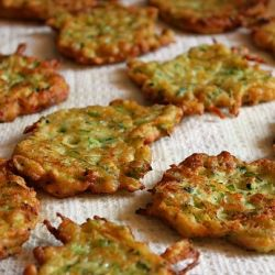 Mario Batali's recipe for Zucchini-Ricotta Fritters. Can be made ahead and reheated in the oven!  - I like all those things!