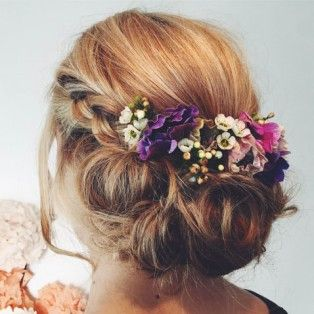We always rate florals and bespoke arrangements to add a unique touch to wedding hair looks. These rustic buds fitted beautifully within this pretty up-do.