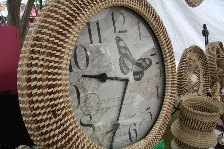 Barbara Manigault uses sweetgrass to trim a clock.