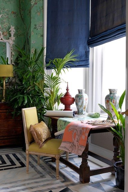 A patterned living room with small table sitting area in a small London flat with antique furniture & patterned wallpaper. Interior design ideas and inspiration from HOUSE by House & Garden.