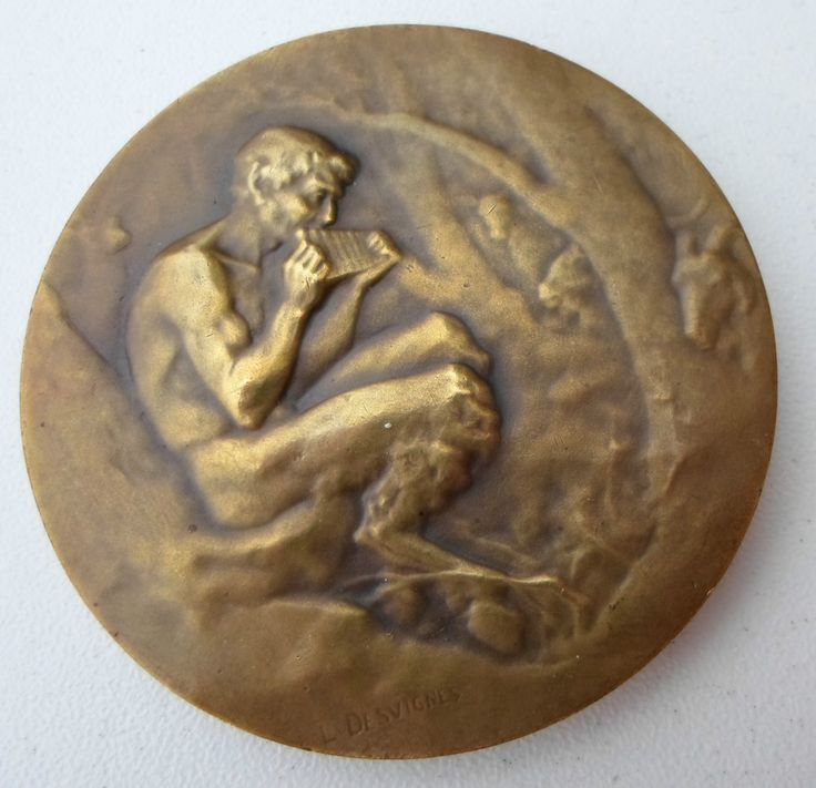 Pan - ancient Greek coin.  This is not an ancient coin.  It is actually a medal minted in the late 18th or early 19th centuries.