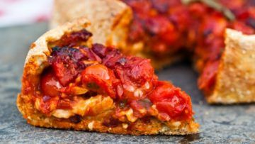 A fantastic Chicago style deep dish pizza made with a delicious and spicy tomato sauce and a super melty stretchy gooey vegan mozzarella. This fantastic pizza is so delicious that everyone will love it! #vegan #recipes #veganfood #deepdish #pizza #dinner
